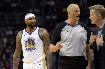 Feb 25, 2019; Charlotte, NC, USA; Golden State Warriors forward center DeMarcus Cousins (0) looks on as head coach Steve Kerr and an official discuss a technical foul called during the second half against the Charlotte Hornets at the Spectrum Center. Warriors won 121-110. Mandatory Credit: Sam Sharpe-USA TODAY Sports