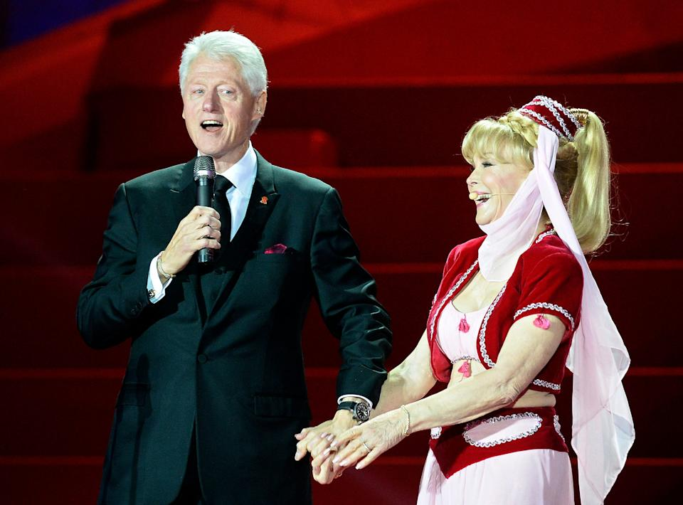 Barbara Eden, alongside former president Bill Clinton, puts on her Jeannie costume once more during the opening ceremony of the 2013 Life Ball in Vienna, Austria.