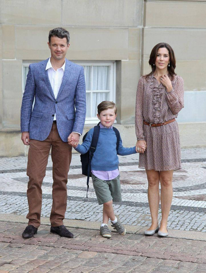 <p>August 2011: Prince Christian poses with his mum and dad on his first day of school. Photo: Getty Images.</p>