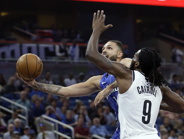 "<a class=""link rapid-noclick-resp"" href=""/nba/players/5054/"" data-ylk=""slk:Evan Fournier"">Evan Fournier</a> highlights this week's look at risers and fallers in fantasy hoops (AP Photo/John Raoux)"