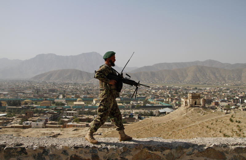 An Afghan National Army walks on Nader Khan Hill in Kabul, Afghanistan, Monday, Aug, 19, 2013. Afghan officials mark the country's 94th independence day from Britain with a small military parade and folk festivals in the capital. (AP photo/Ahmad Jamshid)