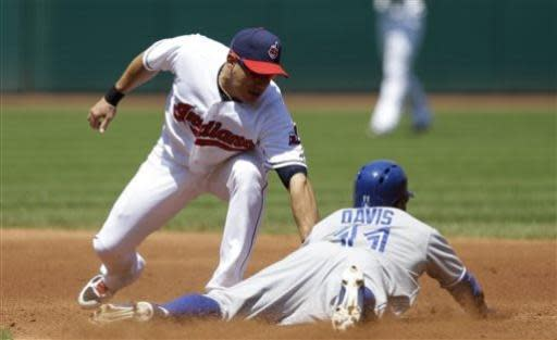 Cleveland Indians' Asdrubal Cabrera, left, is late on the tag as Toronto Blue Jays' Rajai Davis slides safely into second base for a steal in the third inning of a baseball game, Thursday, July 11, 2013, in Cleveland. (AP Photo/Tony Dejak)