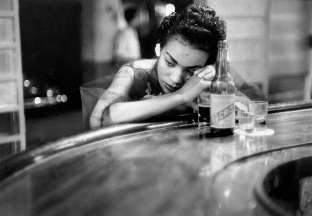 "<p>Bar girl in a brothel in the red-light district, Havana, Cuba, 1954. ""I have been poor and I wanted to document poverty; I had lost a child and I was obsessed with birth; I was interested in politics and I wanted to know how it affected our lives; I am a woman and I wanted to know about women."" (© Eve Arnold/Magnum Photos) </p>"