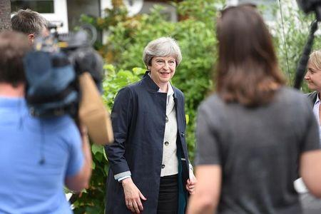 May avoids debate as Labour cuts Tory lead