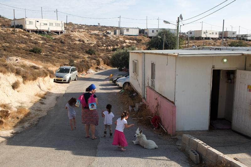 Israeli parliament gives preliminary OK to settlement bill