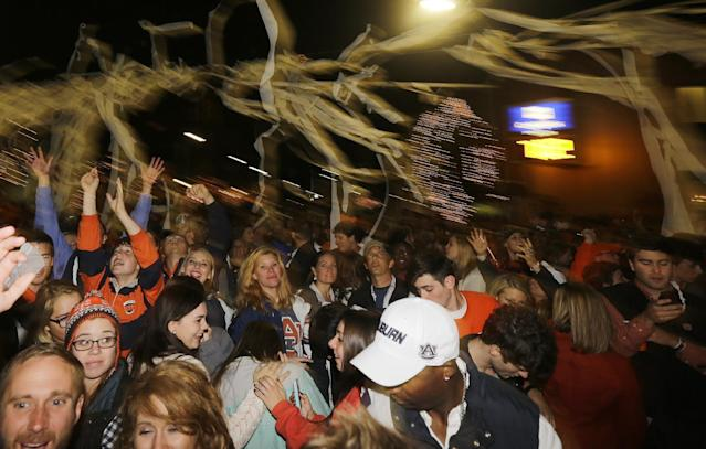 Auburn fans roll Toomer's Corner following their 34-28 win over No. 1 Alabama in an NCAA college football game in Auburn, Ala., Saturday, Nov. 30, 2013. (AP Photo/Jay Sailors)