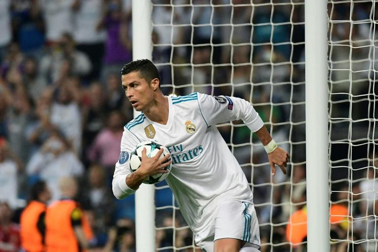 Real Madrid's forward Cristiano Ronaldo celebrates after scoring on a penalty kick at the Santiago Bernabeu stadium in Madrid on September 13, 2017