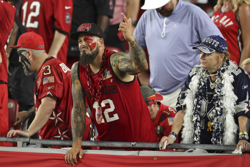 Fans react during the second half of an NFL football game between the Tampa Bay Buccaneers and the Dallas Cowboys on Thursday, Sept. 9, 2021, in Tampa, Fla. (AP Photo/Mark LoMoglio)