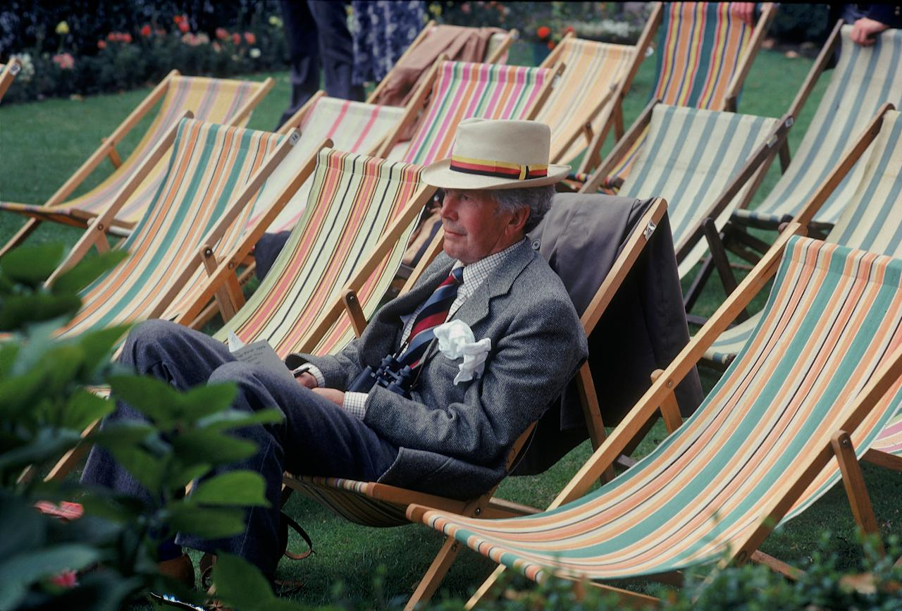 England - 1985:  A Spectator watches Village Green Cricket. (Photo by Adrian Murrell/Getty Images)