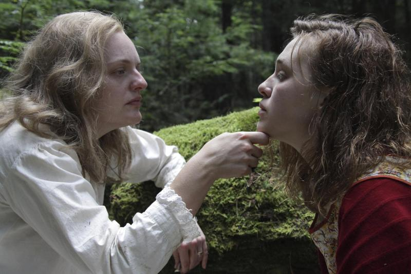 "This image released by Neon shows Elisabeth Moss, left, and Odessa Young in a scene from ""Shirley."" (Neon via AP)"