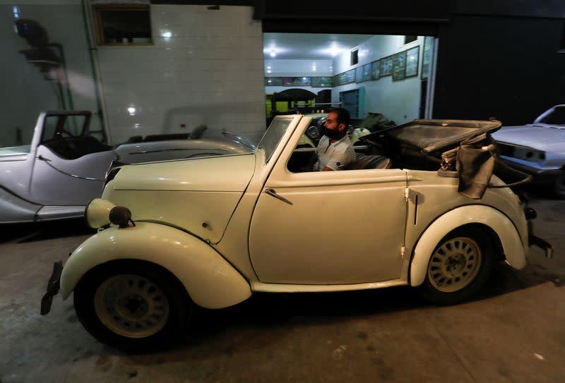 Ayman Sima, the 38-years-old son of Sayed Sima, an Egyptian collector of vintage cars, drives a British Standard Flying Eight Tourer - 1948 automobile at his father's store where he also has an exhibition of old cars, in the Giza suburb of Abu Rawash
