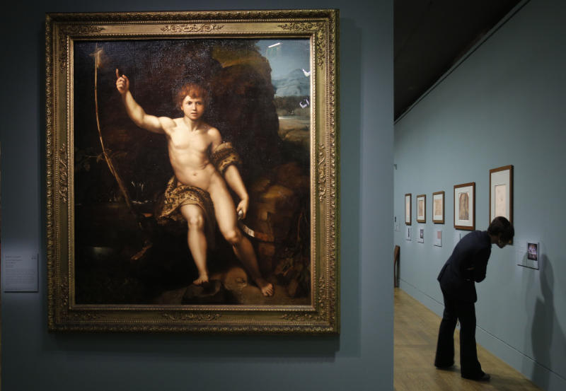 """""""Saint Jean Baptiste dans le desert"""", a painting by Raphael is presented as part of the exhibition """"Late Raphael"""" at the Louvre museum, in Paris, Tuesday, Oct. 9, 2012. This exhibition, organized by the Louvre from Oct. 11 to Jan. 14, 2013 in partnership with the Prado Museum, brings together the works produced by Raphael in Rome during the last years of his life. (AP Photo/Christophe Ena)"""