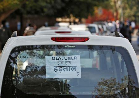 FILE PHOTO: A note is pasted on a rear window of a car during a protest by Uber and Ola drivers, in New Delhi