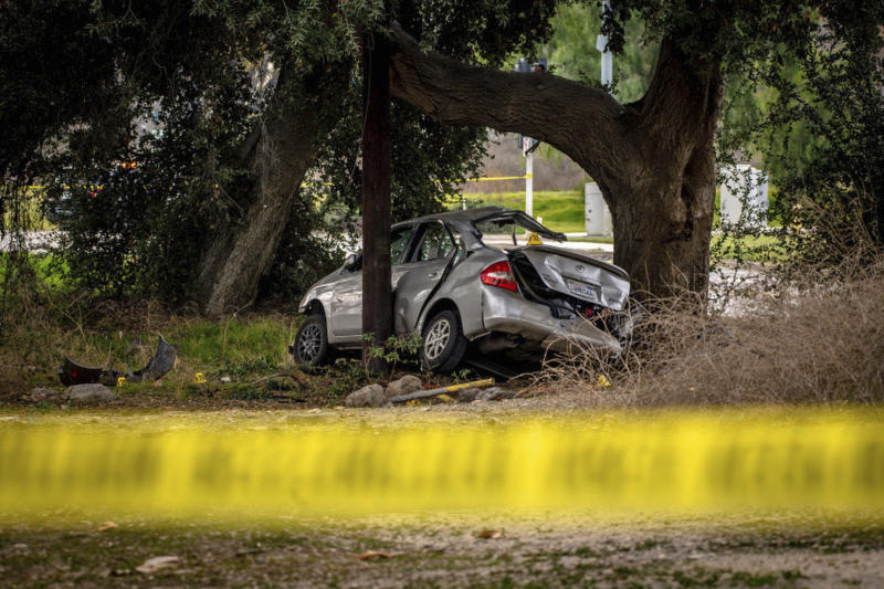 This photo shows a Toyota Prius at the scene of a deadly crash in the Temescal Valley, south of Corona, Calif., Monday, Jan. 20, 2020. A Southern California driver intentionally rammed the Prius with several teenage boys inside, killing a few and injuring a few others before fleeing, authorities said Monday. (Watchara Phomicinda/The Orange County Register via AP)