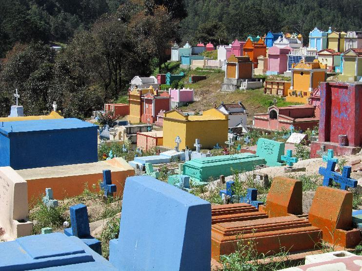 This February 2013 photo shows the colorful cemetery in Chichicastenango, Guatemala, where graves carry symbols of the Mayan and Catholic faiths. Chichicastenango is also famed for an expansive local crafts market. (AP Photo/Amir Bibawy)