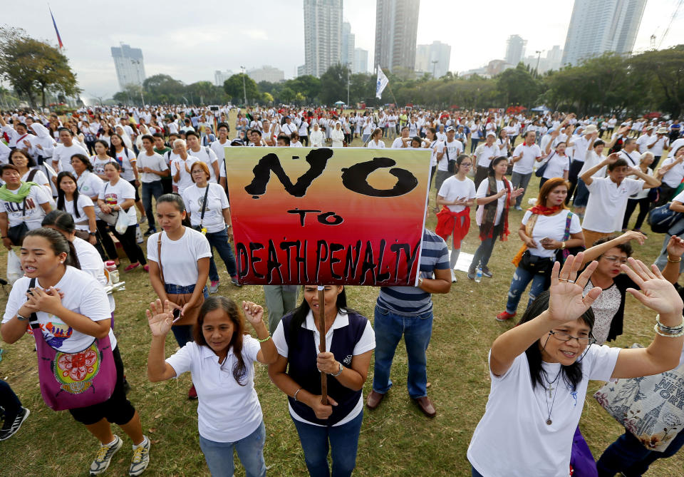 "FILE PHOTO: Thousands of Roman Catholics sing religious songs following a ""Walk for Life"" march around Manila's Rizal Park to oppose the revival of the death penalty by the Philippine Congress as well as the killings of drug users and drug pushers in the so-called war on drugs by President Rodrigo Duterte at dawn Saturday, Feb. 18, 2017 in Manila, Philippines. (AP Photo/Bullit Marquez)"