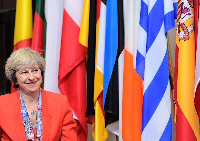 British Prime Minister Theresa May has sought to allay fears of the disruptive impact of Brexit after a wave of criticism (AFP Photo/Emmanuel Dunand)