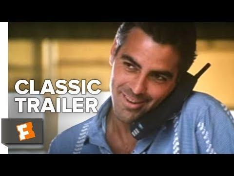 """<p>The film that firmly established Clooney's cooler-than-cool big-screen persona, Steven Soderbergh's 1998 romantic crime comedy is the ideal marriage of star, director, and material. Clooney is the epitome of charismatic ne'er-do-well charm as Jack Foley, a bank robber who finds himself pursued by—and eventually involved with—Jennifer Lopez's U.S. Marshall Karen Sisco. Adapted from Elmore Leonard's novel, Soderbergh's sleek, jaunty, color-coded gem straddles various genre lines with exhilarating flair, aided by an exceptional cast that includes Ving Rhames, Don Cheadle, Steve Zahn, Dennis Farina and Albert Brooks. Even with such luminaries on board, however, it's Clooney who shines brightest in <em>Out of Sight</em>, his whip-smart wit and ladies' man suaveness generating intense sparks with Lopez (especially in their unforgettable car-trunk meet-cute), and proving, once and for all, that he's the preeminent matinee idol of the modern age. — <em>NS</em></p><p><a class=""""link rapid-noclick-resp"""" href=""""https://www.amazon.com/Out-Sight-George-Clooney/dp/B000I9WWCW?tag=syn-yahoo-20&ascsubtag=%5Bartid%7C10054.g.36686692%5Bsrc%7Cyahoo-us"""" rel=""""nofollow noopener"""" target=""""_blank"""" data-ylk=""""slk:Watch Now"""">Watch Now</a></p><p><a href=""""https://www.youtube.com/watch?v=ZmfG7YF_5MA"""" rel=""""nofollow noopener"""" target=""""_blank"""" data-ylk=""""slk:See the original post on Youtube"""" class=""""link rapid-noclick-resp"""">See the original post on Youtube</a></p>"""