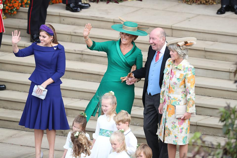 Britain's Princess Beatrice of York (L), Sarah, Duchess of York (C) and parents of the groom Nicola (R) and George Brooksbank wave off the married couple after attending the wedding of Britain's Princess Eugenie of York and Jack Brooksbank at St George's Chapel, Windsor Castle, in Windsor, on October 12, 2018. (Photo by Andrew Matthews / various sources / AFP)        (Photo credit should read ANDREW MATTHEWS/AFP via Getty Images)
