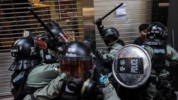 PHOTO: Riot police detain two men in the Central district of Hong Kong on November 11, 2019, as clashes ignited across the city and and crowds took to the streets to block roads and hurl insults at officers. (Photo by DALE DE LA REY/AFP via Getty Images) (Dale De La Rey/AFP via Getty Images)
