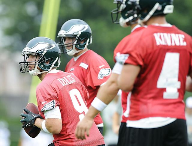 Philadelphia Eagles' Nick Foles (9) drops back to pass during NFL football training camp on Saturday, July 26, 2014, in Philadelphia. (AP Photo/Michael Perez)