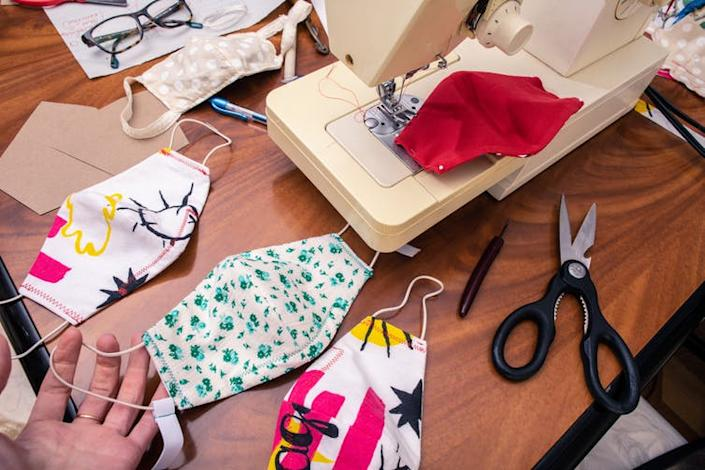 """<span class=""""caption"""">People are making masks at home to cover the lack of PPE supplies for hospitals.</span> <span class=""""attribution""""><a class=""""link rapid-noclick-resp"""" href=""""https://www.shutterstock.com/image-photo/stack-fabric-cloth-sewn-masks-colorful-1699158196"""" rel=""""nofollow noopener"""" target=""""_blank"""" data-ylk=""""slk:Logra/Shutterstock"""">Logra/Shutterstock</a></span>"""