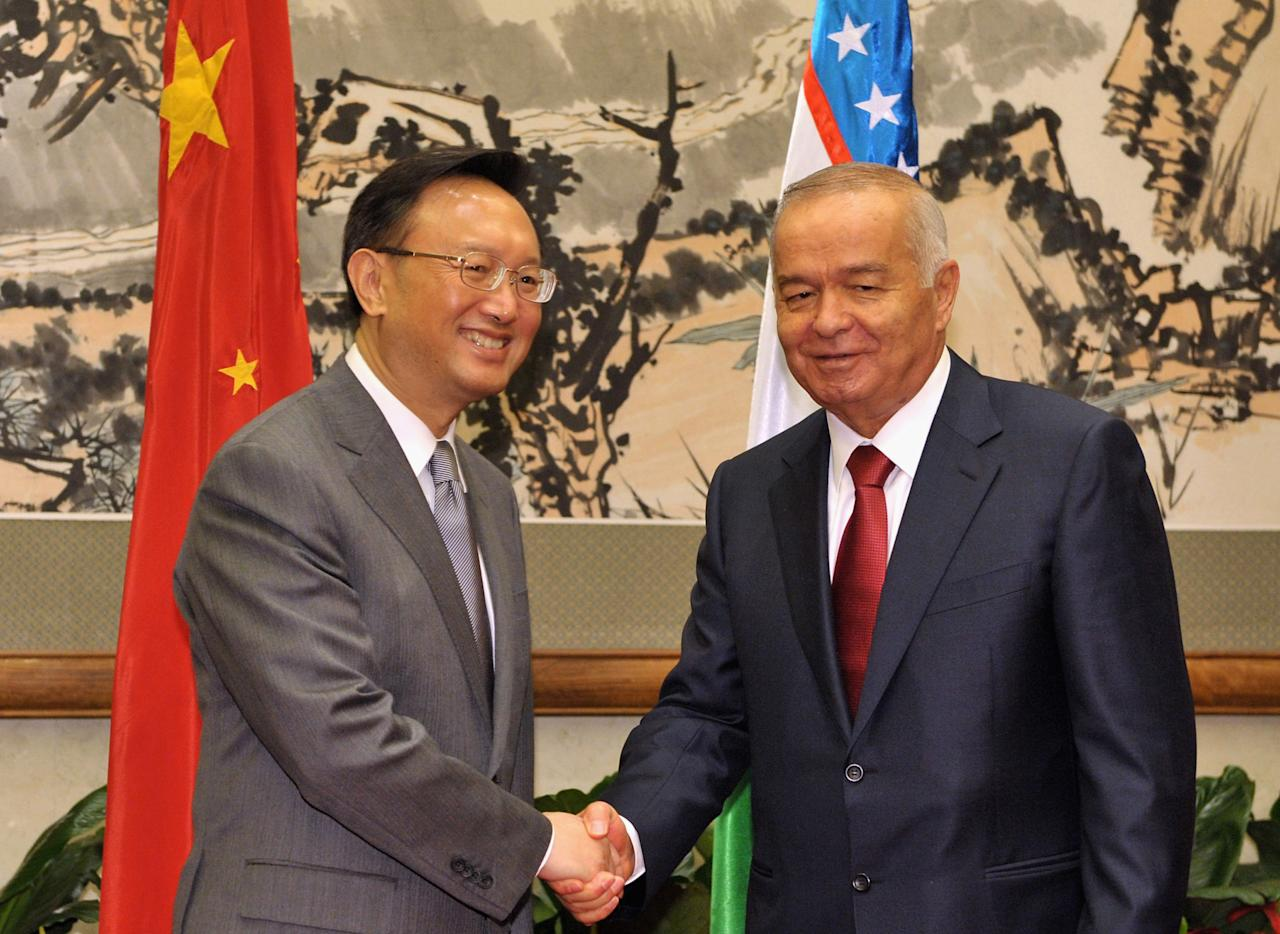BEIJING, CHINA - APRIL 20:  (L-R) China's Foreign Minister Yang Jiechi shakes hands with Uzbekistan President Islam Karimov during their meeting at the Diaoyutai State Guesthouse on April 20, 2011 in Beijing, China. Karimov is in China on a two day visit to discuss Uzbek-Chinese Relations. (Photo by Kota Kyogooku-Pool/Getty Images)