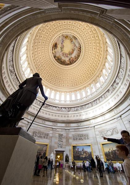 This March 1, 2013 photo shows visitors touring the Rotunda of the U.S. Capitol in Washington. There are probably more free things to do in the U.S. capital than nearly any other major city in the world. The most popular museums and the zoo are free, thanks to government funding, as well as the picturesque memorials and monuments. With so many free options, the biggest challenge might be narrowing down what to see. (AP Photo/Alex Brandon)