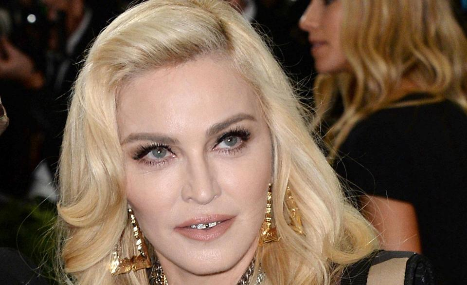 Madonna has responded to butt implant speculation (PA Images)