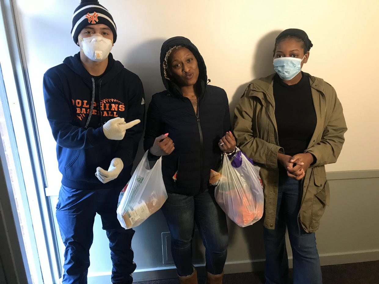Jalen Kobayashi, Deja Swint, and Alycia Kamil, volunteers from the youth-led anti-gun violence group Good Kids Mad City, deliver groceries to neighbors in Chicago. (Good Kids Mad City / via Twitter)