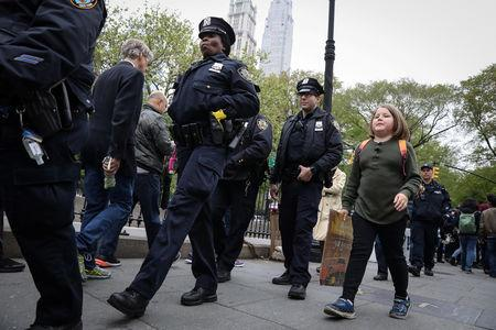FILE PHOTO:  Climate change activist Zayne Cowie walks on the Brooklyn Bridge during a youth climate march in New York City, U.S., May 3, 2019.  REUTERS/Brendan McDermid