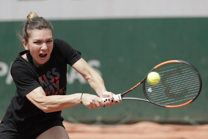 Simona Halep recovers from slow start to reach French Open second round