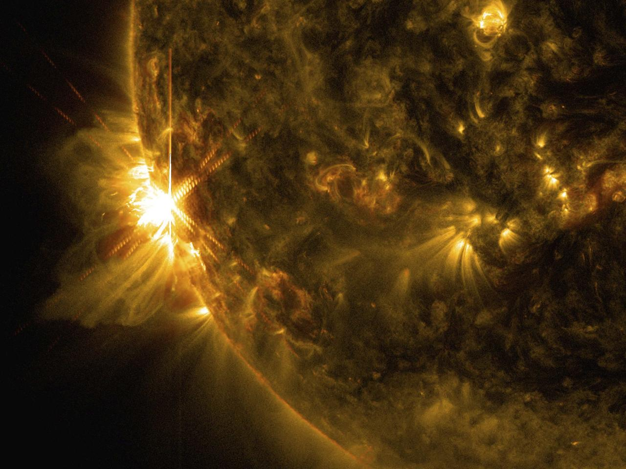 A solar flare bursts off the left limb of the sun in this image captured by NASA's Solar Dynamics Observatory at 07:41 EST (11:41 GMT) June 10, 2014, This is classified as an X2.2 flare, shown in a blend of two wavelengths of light: 171 and 131 angstroms, colorized in gold and red, respectively, according to a NASA news release. REUTERS/NASA/SDO/Goddard/Wiessinger/Handout via Reuters (OUTER SPACE - Tags: SCIENCE TECHNOLOGY) ATTENTION EDITORS - THIS PICTURE WAS PROVIDED BY A THIRD PARTY. REUTERS IS UNABLE TO INDEPENDENTLY VERIFY THE AUTHENTICITY, CONTENT, LOCATION OR DATE OF THIS IMAGE. FOR EDITORIAL USE ONLY. NOT FOR SALE FOR MARKETING OR ADVERTISING CAMPAIGNS. THIS PICTURE IS DISTRIBUTED EXACTLY AS RECEIVED BY REUTERS, AS A SERVICE TO CLIENTS
