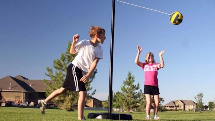 Kids will love playing tetherball in the yard with this portable system.