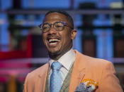 """Talk show host Nick Cannon poses for a portrait on the set of """"Nick Cannon"""" at Metropolitan Studios in New York on Sept. 16, 2021. His nationally syndicated daytime talk show premieres Sept. 27 on Fox Television Stations. (Photo by Andy Kropa/Invision/AP)"""
