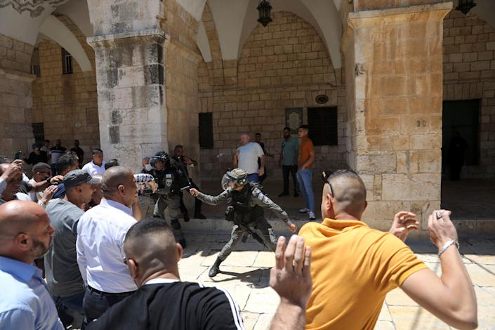Israeli police battle Muslim worshippers trying to gather for Friday prayers at the Dome of the Rock Mosque in the Al-Aqsa Mosque compound in the Old City of Jerusalem on May 14.