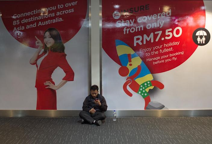 AirAsia advertisements are seen at the low-cost carrier Kuala Lumpur International Airport 2 (KLIA2) in Sepang, on January 10, 2015 (AFP Photo/Mohd Rasfan)