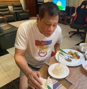Duterte with his rice cake. Photo: Senator Christopher 'Bong' Go