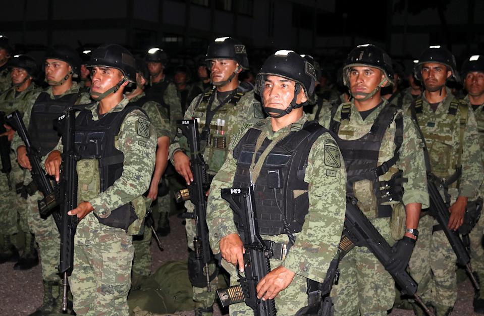 "Members of a special unit of the Mexican Army are seen at a military zone as part of an operation to increase security after cartel gunmen clashed with federal forces, resulting in the release of Ovidio Guzman from detention, the son of drug kingpin Joaquin ""El Chapo"" Guzman, in Culiacan, in Sinaloa state, Mexico October 20, 2019. REUTERS/Stringer"