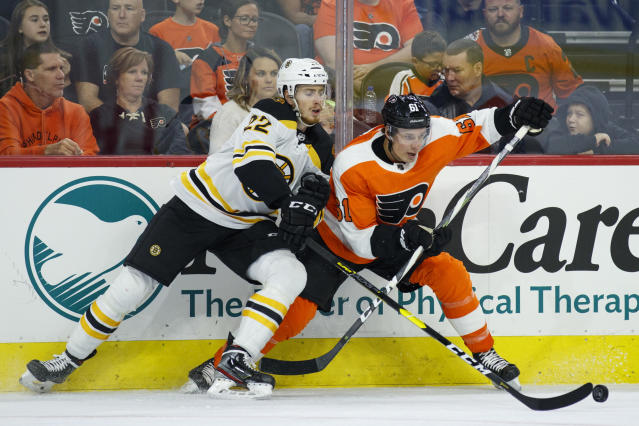 Boston Bruins' Peter Cehlarik, left, and Philadelphia Flyers' Justin Braun vie for the puck during the second period of a preseason NHL hockey game Thursday, Sept. 19, 2019, in Philadelphia. (AP Photo/Matt Slocum)