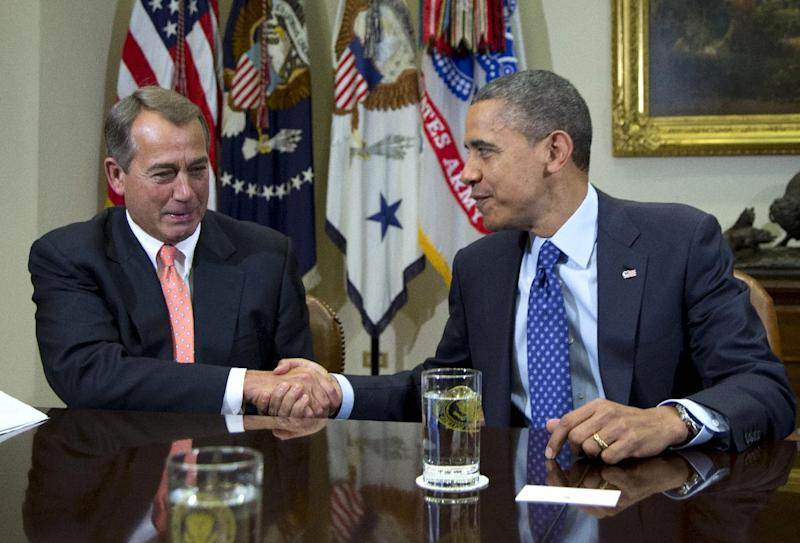 "FILE - This Nov. 16, 2012 file photo shows President Barack Obama shaking hands with House Speaker John Boehner of Ohio in the Roosevelt Room of the White House in Washington, during a meeting to discuss the deficit and economy. Congress and the White House can significantly soften the initial impact of the ""fiscal cliff"" even if they fail to reach a compromise by Dec. 31. One thing they cannot control, however, is the financial markets' reaction, which possibly could be a panicky sell-off that triggers economic reversals worldwide. The stock market's unpredictability is perhaps the biggest wild card in the political showdown over the fiscal cliff. (AP Photo/Carolyn Kaster, File)"
