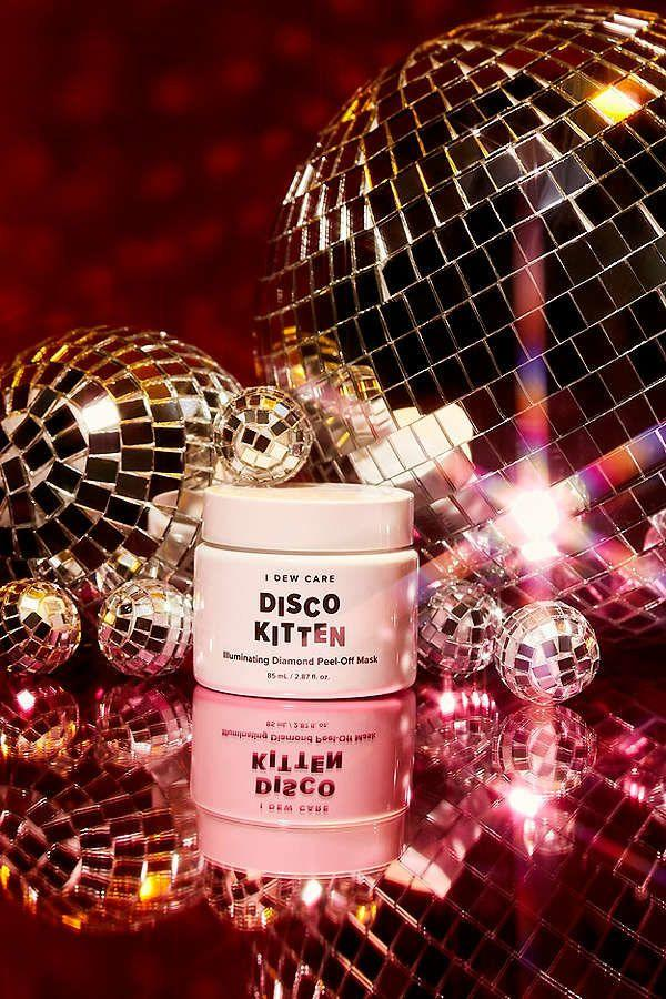 """Made with am mixture of pearl powder and diamond powder, this K-beauty product softens skin while improving complexion.Its glittery texture feels a bit like Elmer's school glue -- but don't let that fool you. This brightening mask will leave you feeling like a million bucks. <a href=""""https://www.urbanoutfitters.com/shop/i-dew-care-disco-kitten-illuminating-diamond-peel-off-mask?category=SHOPBYBRAND&color=010"""" target=""""_blank"""">Shop it here</a>."""