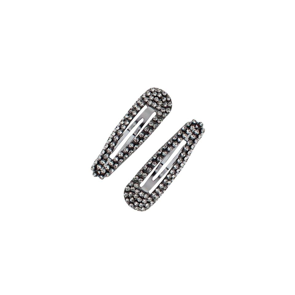 """<p><strong>Kitsch</strong></p><p>mykitsch.com</p><p><strong>$12.00</strong></p><p><a href=""""https://mykitsch.com/collections/kitsch-x-justine-marjan/products/rhinestone-snap-clips-hematite"""" rel=""""nofollow noopener"""" target=""""_blank"""" data-ylk=""""slk:Shop Now"""" class=""""link rapid-noclick-resp"""">Shop Now</a></p><p>We can't get enough of these fun rhinestone clips that'll jazz up any pony or stray hairs. </p>"""