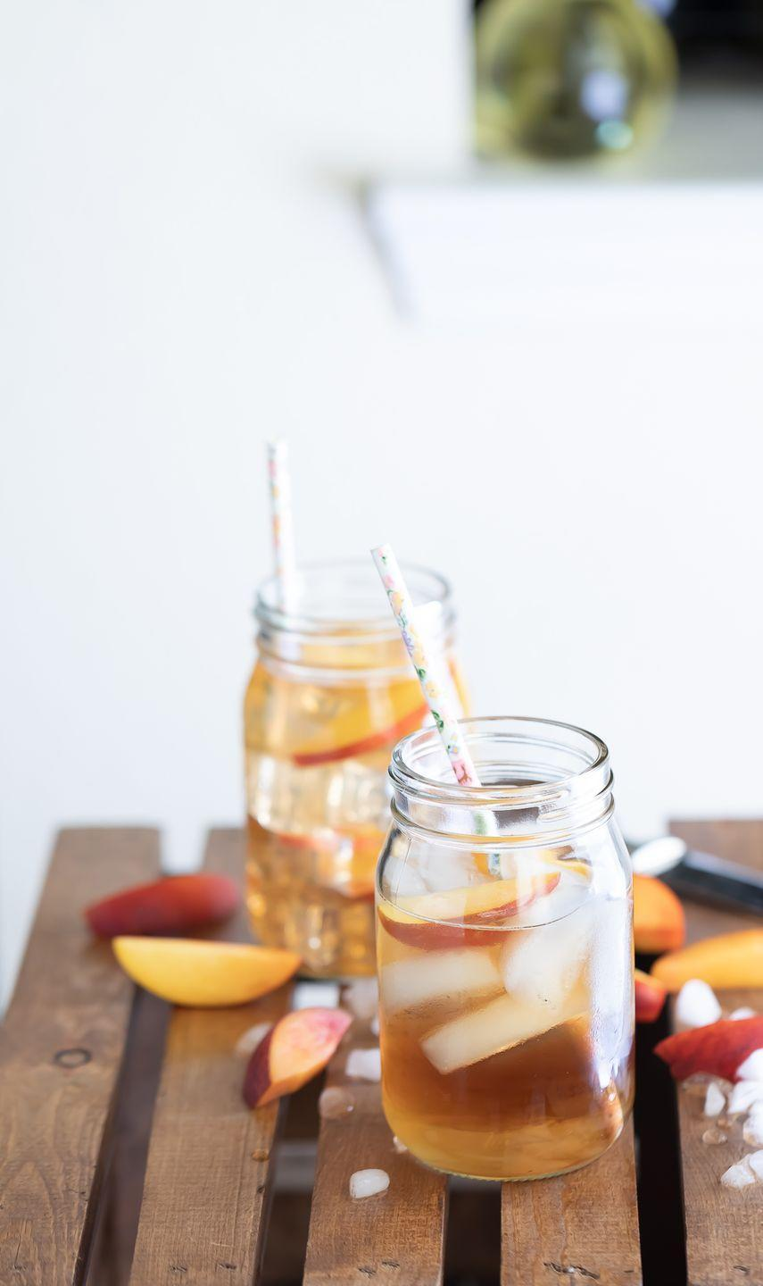 """<p>This Long Island Iced Tea has a Southern twist thanks to a splash of peach liqueur. It's light, refreshing, and perfect for drinking outdoors.</p><p><strong>Get the recipe at <a href=""""https://savoryspicerack.com/georgia-peach-cocktail/"""" rel=""""nofollow noopener"""" target=""""_blank"""" data-ylk=""""slk:Savory Spice Rack"""" class=""""link rapid-noclick-resp"""">Savory Spice Rack</a>.</strong><br></p><p><a class=""""link rapid-noclick-resp"""" href=""""https://go.redirectingat.com?id=74968X1596630&url=https%3A%2F%2Fwww.walmart.com%2Fsearch%2F%3Fquery%3Dpioneer%2Bwoman%2Bcooking%2Btools&sref=https%3A%2F%2Fwww.thepioneerwoman.com%2Ffood-cooking%2Fmeals-menus%2Fg36432840%2Ffourth-of-july-drinks%2F"""" rel=""""nofollow noopener"""" target=""""_blank"""" data-ylk=""""slk:SHOP COOKING TOOLS"""">SHOP COOKING TOOLS</a></p>"""