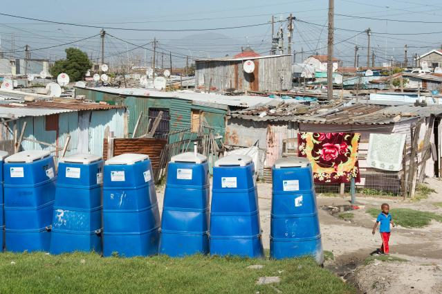 <p>Portable toilets at a settlement in Khayelitsha, a township outside of Cape Town, South Africa. (Photo: Rodger Bosch/AFP/Getty Images) </p>