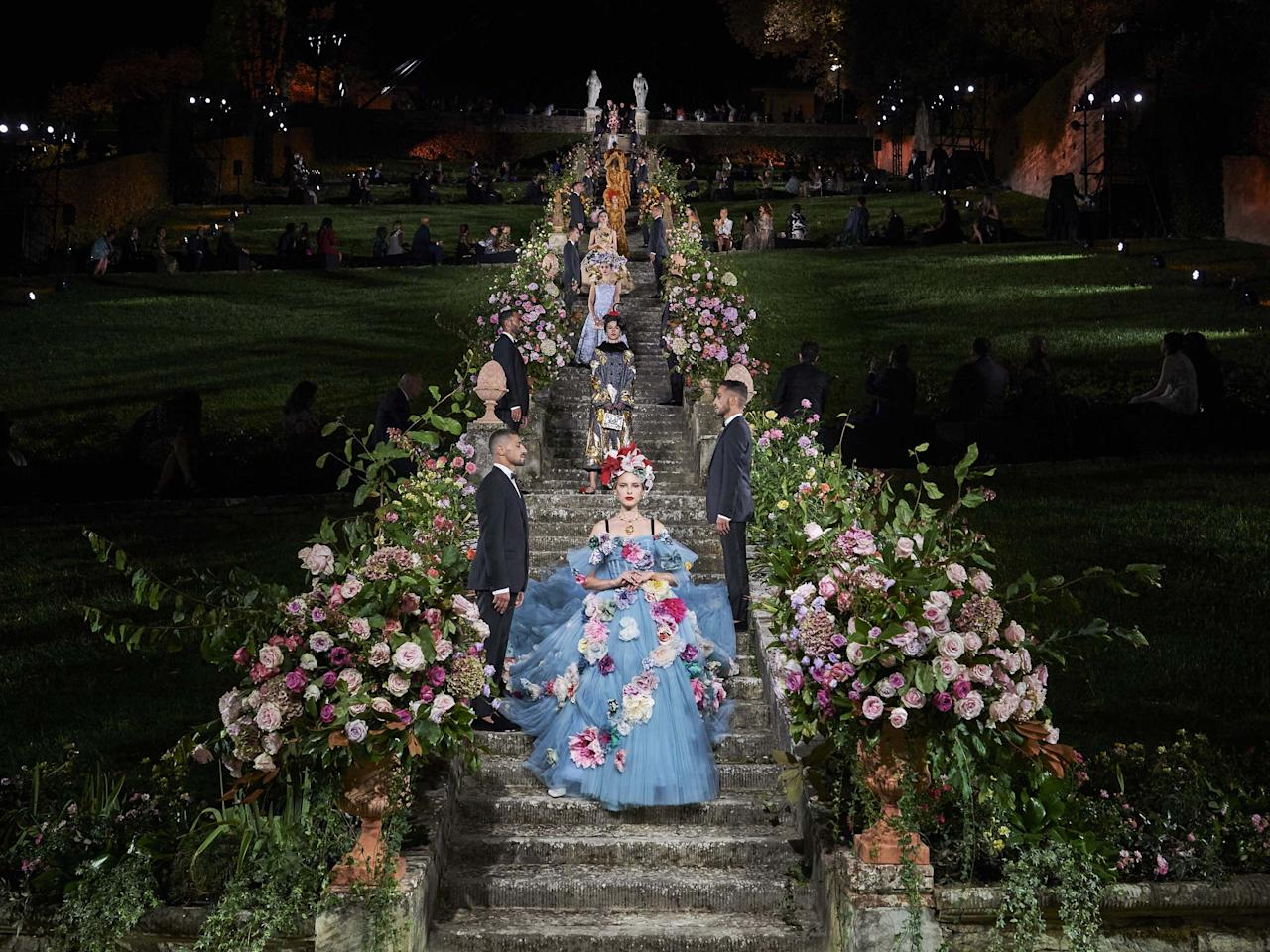 "<p>Last night, Dolce & Gabbana gathered the fashion world together for one of the first major occasions since the coronavirus pandemic began – and the house certainly delivered in reminding everybody of the magic of the fashion show. Housed at the Villa Bardini in Florence yesterday evening, the Italian label presented a breathtaking collection of 89 runway looks, which saw the models walk down the long stone staircase, showcasing pieces which were designed as a tribute to Florence.</p><p>""The inspiration came from the Sixteenth century and the Italian Renaissance,"" designers Domenico Dolce and Stefano Gabbana said in a press release. ""In this historical period, the tailors – and especially the Florentine artisans - created clothes and accessories with what they had in their workshops (the so called botteghe), mixing different materials through the lens of their great creativity. By using and combining elements and materials such as natural or coloured raffia, corals and hard stones, they gave birth to the concept of Arte Povera (Poor Art).""</p><p>The elegance of the colourful collections was all about representing Italian beauty and the flair of Florence. Embroidery, embellishment, 3D flowers and beautiful tulle made up some of the most remarkable pieces. </p><p>Scroll through to see highlights and close-ups from the catwalk, backstage and of the spectacular fireworks display.</p>"