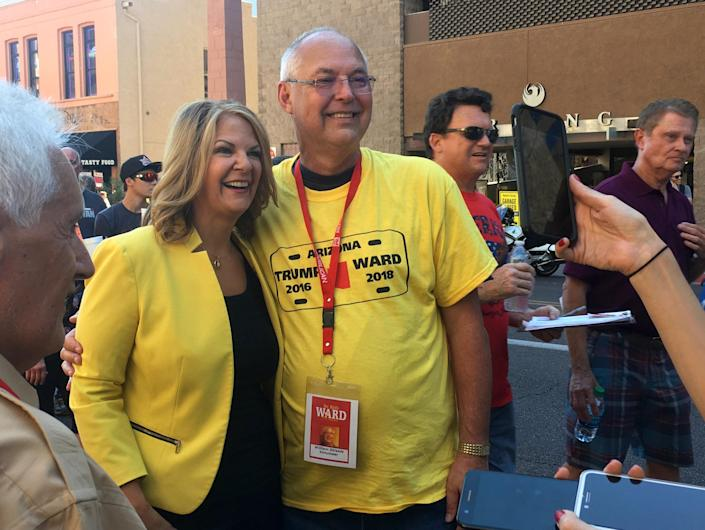 Right-wing Flake challenger Kelli Ward poses with a supporter outside President Trump's rally in Phoenix on Aug. 22. (Photo: Andrew Romano/Yahoo News)