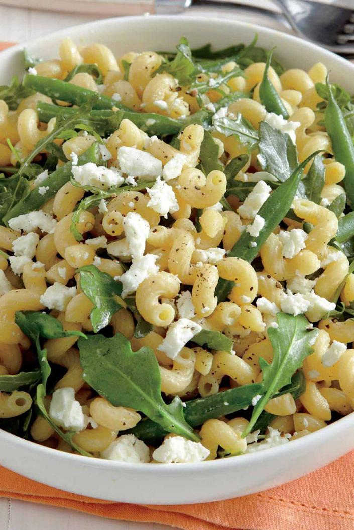 """<p>This spring salad combines fresh green beans and arugula with a sprinkling of feta cheese. </p><p><a href=""""https://www.womansday.com/food-recipes/food-drinks/recipes/a12275/lemony-pasta-salad-green-beans-arugula-recipe-wdy0513/"""" rel=""""nofollow noopener"""" target=""""_blank"""" data-ylk=""""slk:Get the recipe for Lemony Pasta Salad."""" class=""""link rapid-noclick-resp""""><u><em>Get the recipe for Lemony Pasta Salad.</em></u></a></p>"""