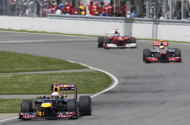 Red Bull Racing driver Sebastian Vettel (L) of Germany leads McLaren Mercedes driver Lewis Hamilton (R) of Britain and Ferrari driver Fernando Alonso of Spain in the Canadian Formula One Grand Prix on June 10, 2012 at the Circuit Gilles Villeneuve in Montreal. AFP PHOTO/DON EMMERTDON EMMERT/AFP/GettyImages