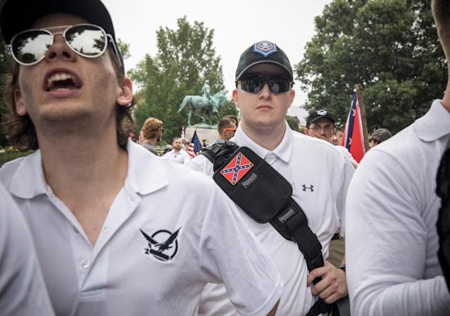 A white supremacist marches in Charlottesville, Virginia, on August 12, 2017, wearing Under Armour. (Photo by Evelyn Hockstein via Getty Images)